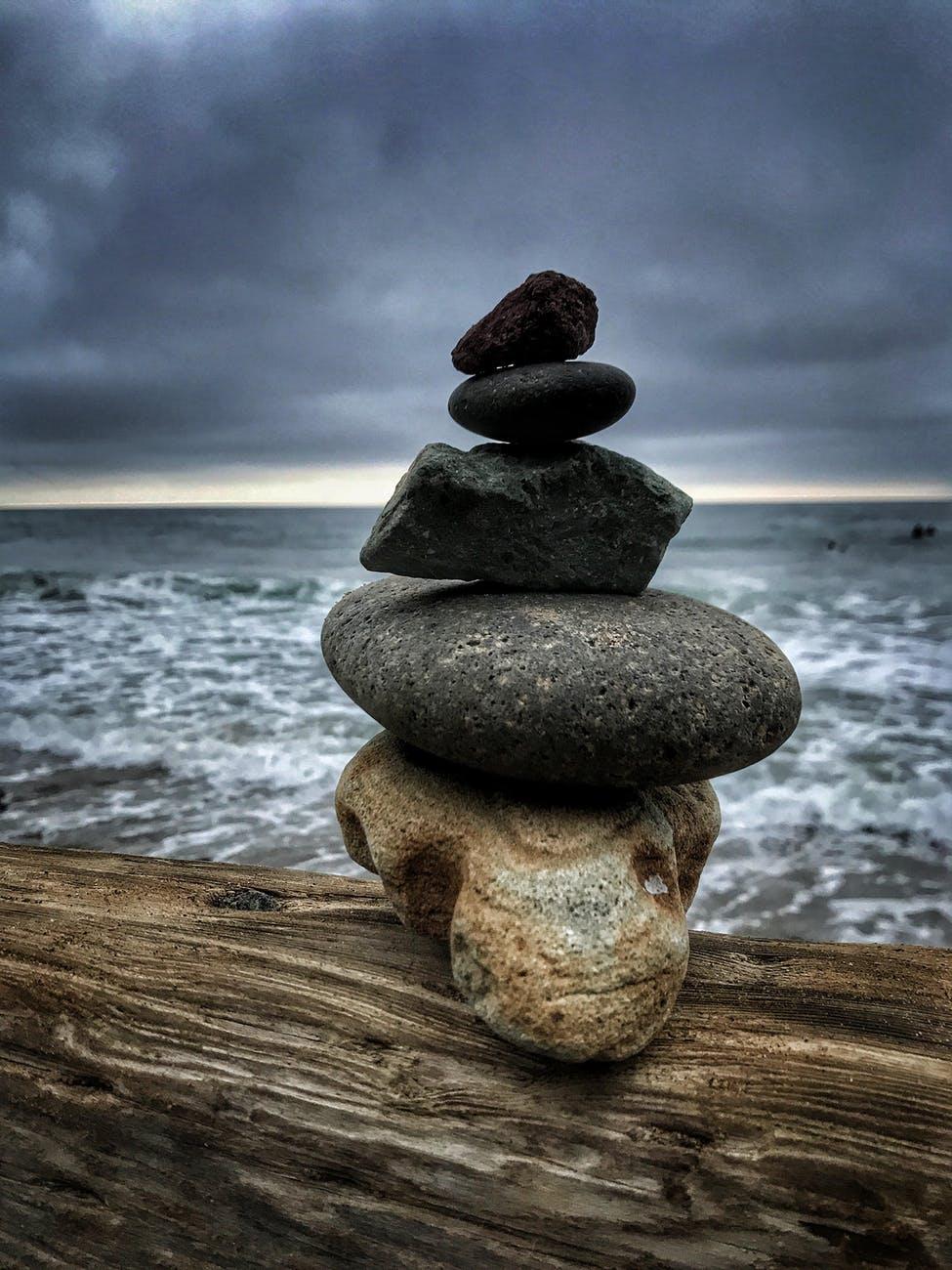 balance beach boulder close up